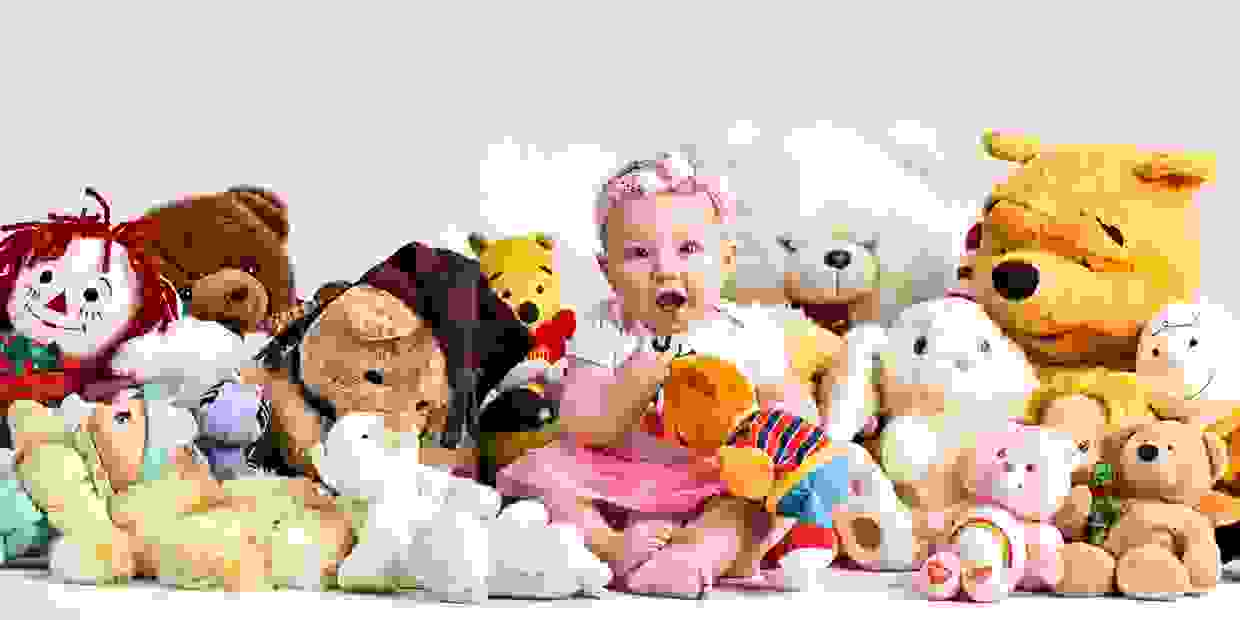 Little girl with stuffed animals at G'Mariecee Portrait Studios in Alexandria MN
