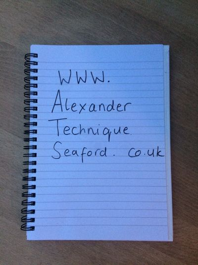 Photo of notebook with 'www.alexandertechniqueseaford.co.uk' hand written on page