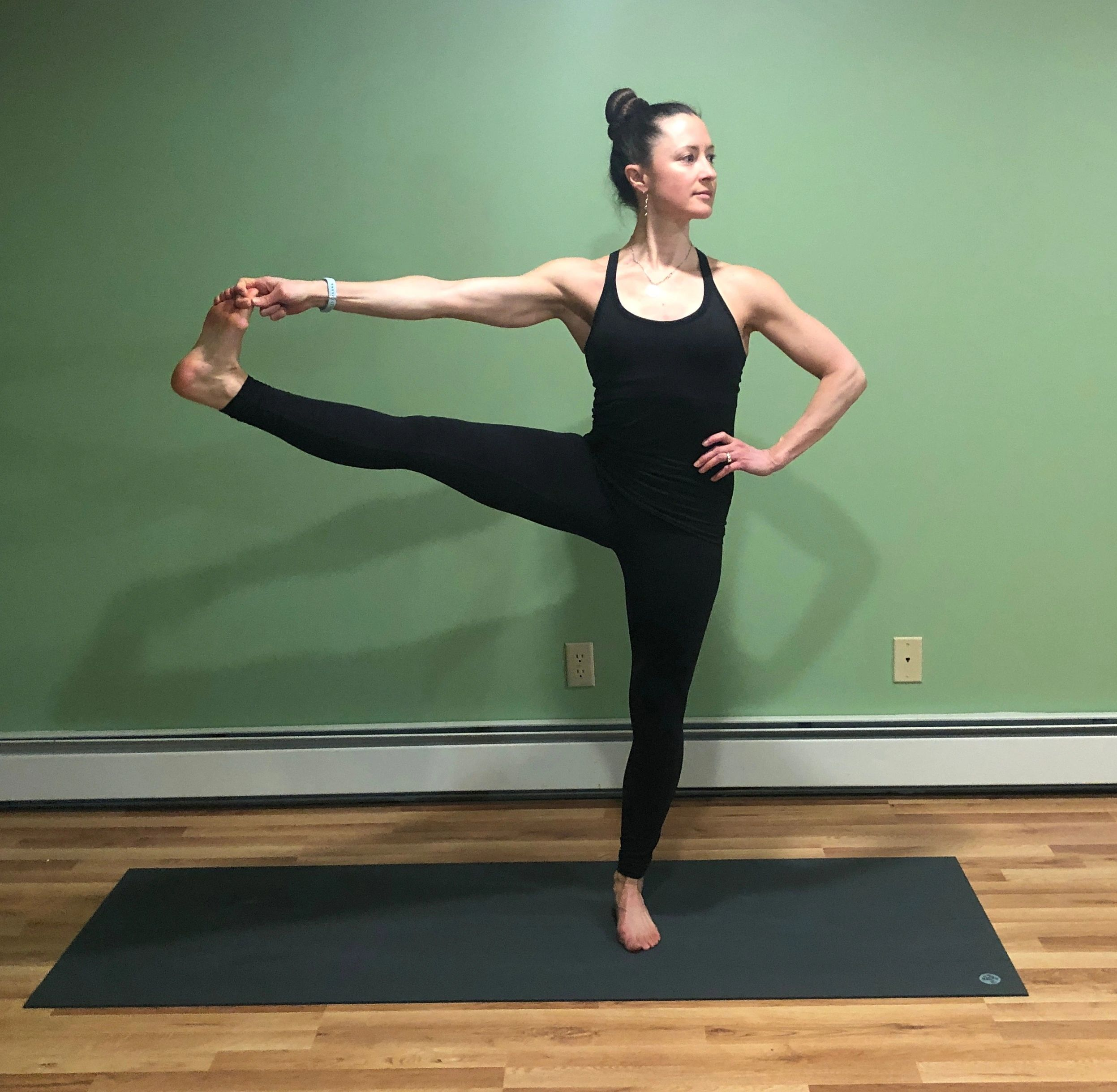 Taryn in standing side hand-to-toe pose (Utthita Hasta Padangusthasana)