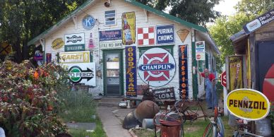Old house in Erik, Oklahoma displaying antique signs fro Route 66.