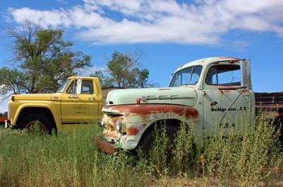 Old vehicles on the side of the road in Seligman, Arizona on Historic Route 66.