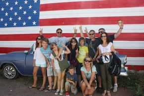 A popular Route 66 photo opportunity is a group photo in front of large American flag