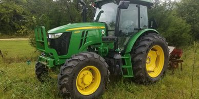 A farm tractor is central to farming.  Attachments preform different functons