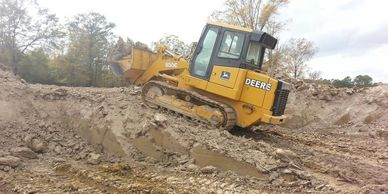 Crawler digging a 20 feet deep pond
