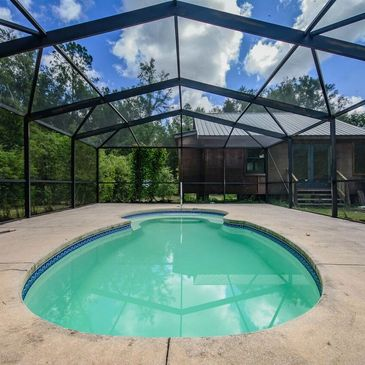 My property consists of an in ground outdoor pool (totally private) on FIVE acres of fenced private