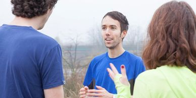 Let's Run Coaching - bespoke training plans - Ben speaking to two clients in Hackney Marshes