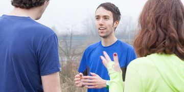 Run with Ben coaching - bespoke training plans - Ben speaking to two clients in Hackney Marshes