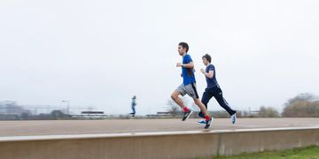Run with Ben running coaching - one-to-one coaching - Ben running with a client in Hackney Marshes