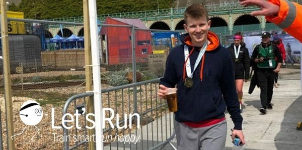 Let's Run Coaching - testimonials - Jack with his medal after the Brighton Marathon