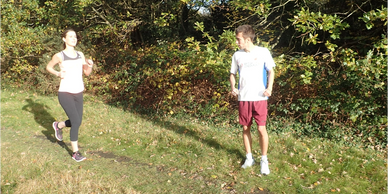 Let's Run Coaching - running form review - Ben helping a runner in Epping Forest