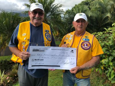 Tournament Director Jerry Moore , KNSL President Patrick O'Connell showing $20,000 Matching Donation