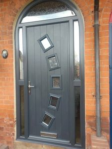 Arhed frame composite front door fitted in Manfield in Anthracite Grey with a matching grey frame.