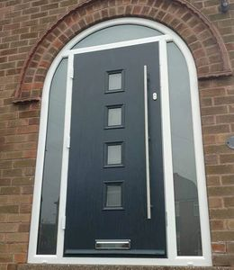 Arched frame composite door fitted in Mansfield Woodhouse in Anthracite Grey with a Long Bar handle.