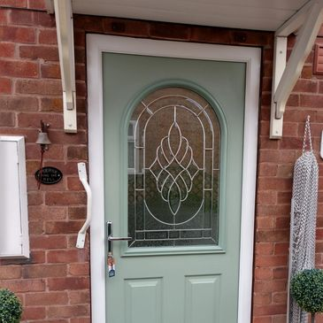Chartwell Green Solid Core composite door fitted with Zinc Art Elegance glass.