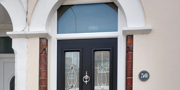 Composite front door fitted with a toplight and triple glazed glass.