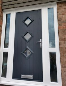 Anthracite Grey Solid Core Composite front door with two side panels with midrails fitted in Clowne.