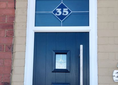 Custom made leaded top light glass with door number. This Composite door was fitted in Huthwaite