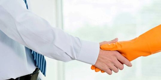 Maid shaking hands with boss.  Cleaner receiving a promotion at work.  Always Ready cleaning jobs.