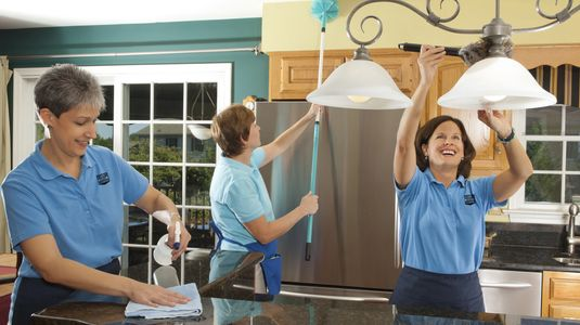 Always Ready Cleaning maids working together to clean a kitchen.  cleaning ladies.  Cleaning jobs