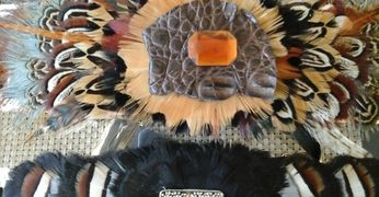 feathered cuffs, feathered belts, marianne vasques,maui artist, feather bracelets