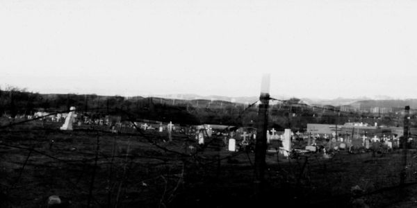 Double pinhole photograph of a cemetery in Hernandez, NM.