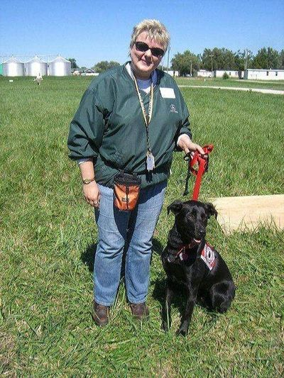 PHARM Dog coordinator Jackie Allenbrand with one her first demonstration dogs, Kristy.