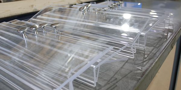 Custom fabricated acrylic display unit fronts.