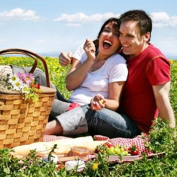 Picture of a 2 people having a picnic.