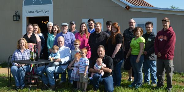 A group picture of friends and family of Chateau MerrillAnne posing in front of the tasting room.