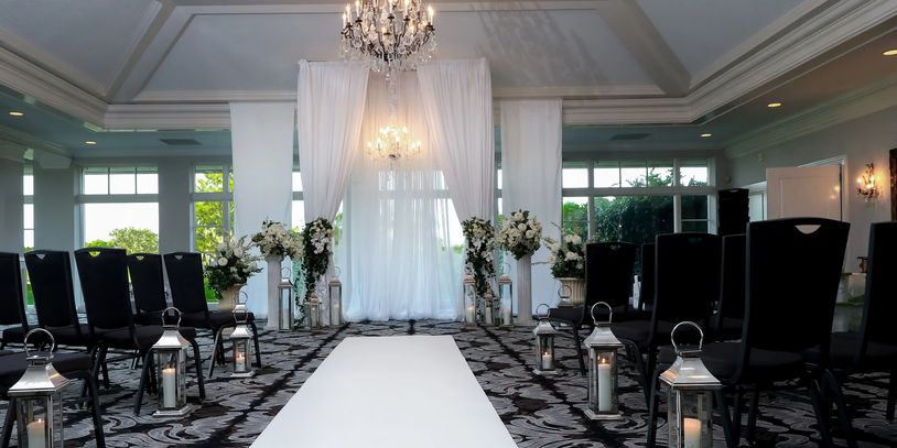 Tall Wedding Facade with Chandeliers -Laurel Oaks Country Club offered by Beach Breeze Weddings