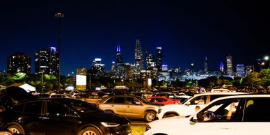Parked cars at a CHI-Together drive-in event at Soldier Field.