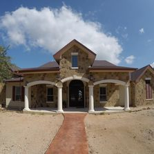 Custom House in the Texas Hill Country.  Rock masonry and stucco exterior