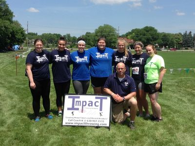 The coach with his proud Impact girls at the USATF Junior Olympics, Lisle, IL, June 2018
