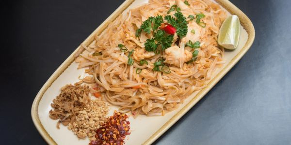 A plate of Pad Thai Chicken - Thai food