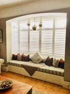 SHUTTERS IN A BOX BAY WINDOW #shutters #lounge #cozy #interiors