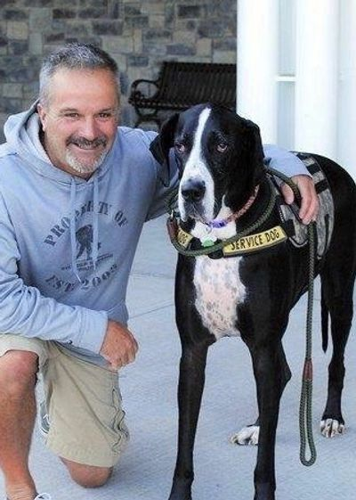 Scott with his Great Dane Service Dog, Dash; an integral part of his presentations and his life.
