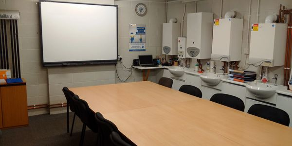One of our gas training classrooms with a range of gas boilers on the wall for training purposes