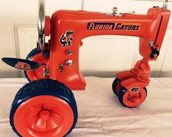 "alt="" Orange sewing machine tractor Higley welding"""