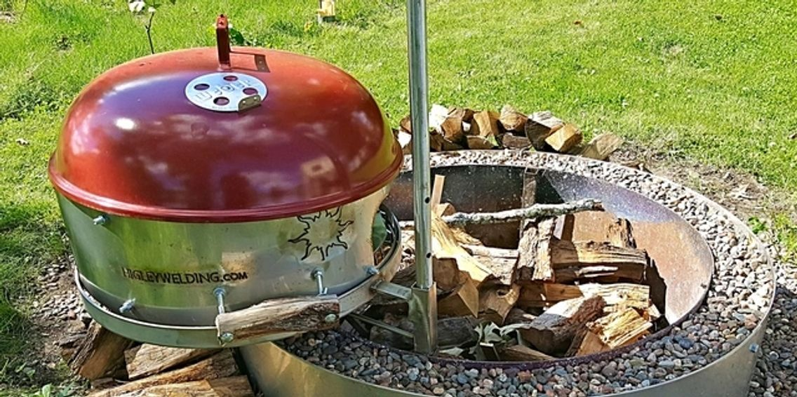 "alt=""double wall fire pit ring made stainless steel with swivel grill and weber cover."""