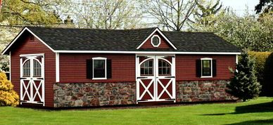Manor Deluxe, optional clapboard siding, red paint, Vermont field stone, carriage doors, extra door
