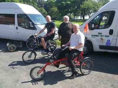 The first bikes have arrived - left-to-right are Rory & Willie from BikeWorks with Duncan from FEAT
