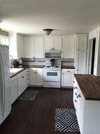 Kitchen renovation, walnut butcher block, painted white cabinets, marble and subway tile, DIY.
