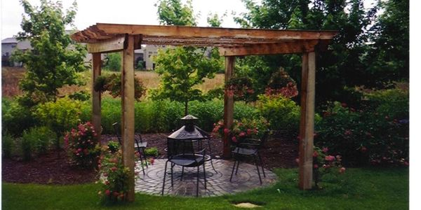 back yard fire pit patio and pergola