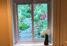 Beautify your unattractive window wells with weather resistant window well scenes.
