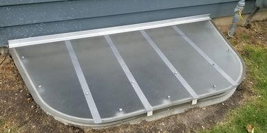 Custom Window Well Cover made of Ge Lexan  and Aluminum Material.