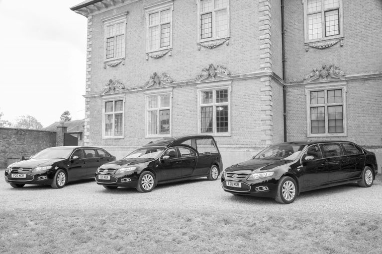 Our fleet of Ford hearse and two limousines