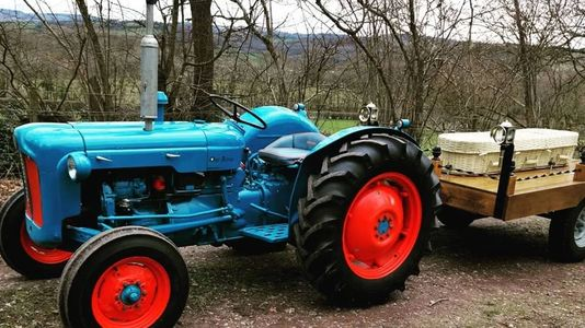 A Blue tractor hearse