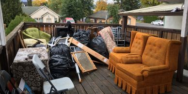 Deck full of furniture left by tenant