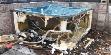 Partially cut up hot tub