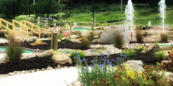 Pine Creek Golf Center has 30 small beds with 400  perennials, bushes, trees, and small boulders!